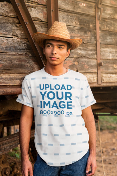 Mockup of a Serious Man With a Sublimates T-Shirt Posing By an Old Train Wagon 42824-r-el2