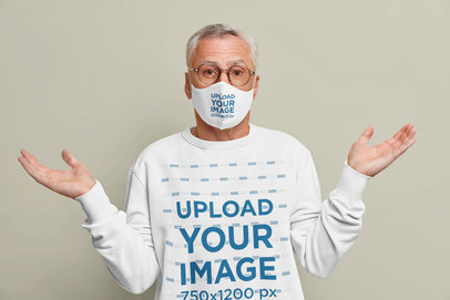 Face Mask and Sweatshirt Mockup of a Confused Man in a Studio m3643-r-el2