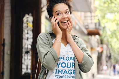 T-Shirt Mockup of a Happy Woman Talking on the Phone on the Street 39696-r-el2