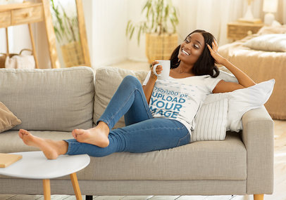 T-Shirt Mockup of a Young Woman Relaxing At Home 46515-r-el2