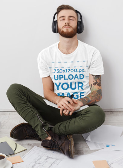 T-Shirt Mockup of a Tattooed Man Listening to Music While Working m2902-r-el2