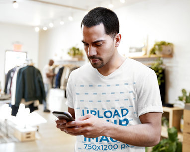V-Neck T-Shirt Mockup of Man Checking Up His Phone in a Store 41879-r-el2