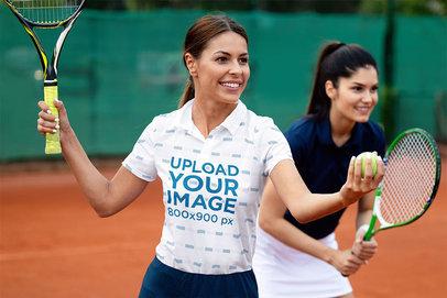 Polo Shirt Mockup of a Female Tennis Player Ready to Serve M2778-r-el2