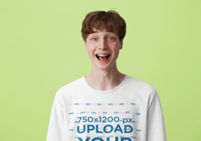 T-Shirt Mockup of a Young Man with a Big Smile in a Studio M4862-r-el2
