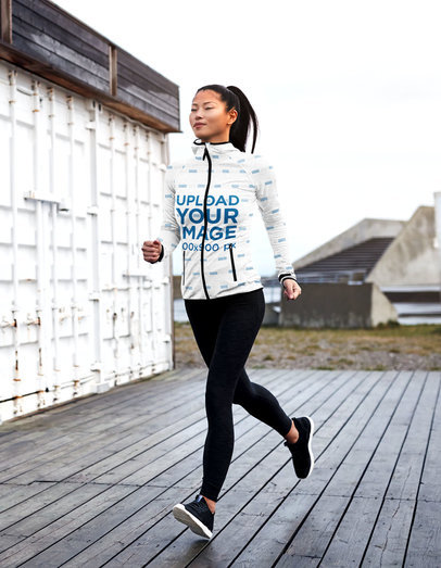 Full-Zip Hoodie Mockup Featuring a Woman Jogging Outside 41137-r-el2