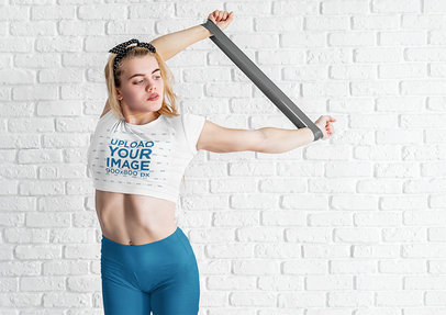 Crop Top Mockup of a Woman Training With a Resistance Band m3382-r-el2