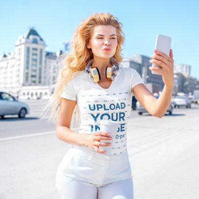 Mockup of a Blonde Woman Taking a Selfie on the Street 40593-r-el2