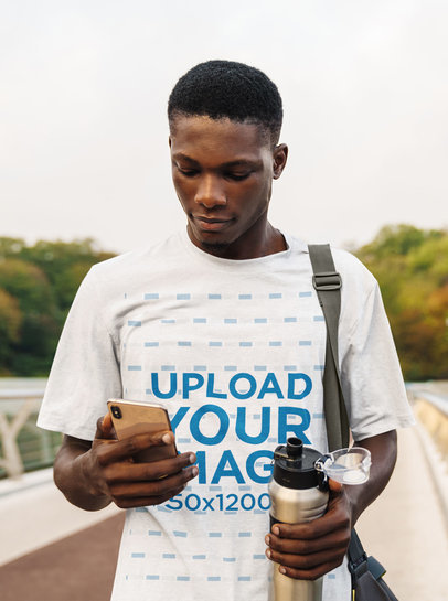 T-Shirt Mockup of a Young Man Checking His Phone After Training M4345-r-el2