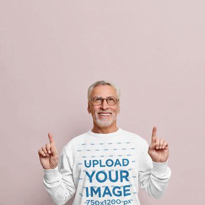 Sweatshirt Mockup of a Senior Man Pointing Upwards m3640-r-el2