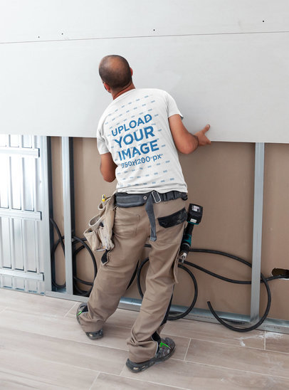 T-Shirt Mockup of a Contractor Working on a Wall m3856-r-el2