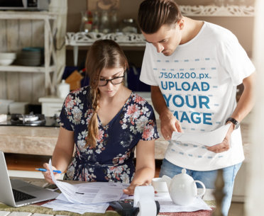 T-Shirt Mockup of a Man Checking Bills With His Wife m3194-r-el2