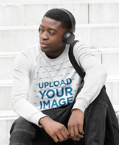 Sweatshirt Mockup of a Man Sitting on Some Steps with His Headphones On m4245-r-el2