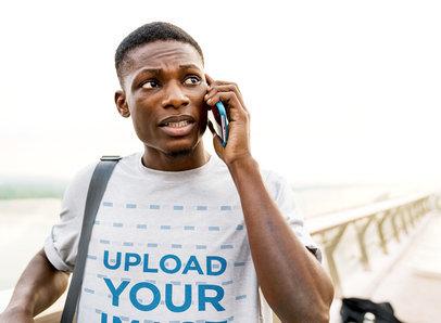 T-Shirt Mockup of a Worried Man Talking on the Phone M4337-r-el2
