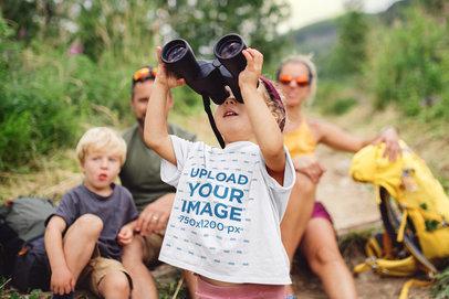 T-Shirt Mockup of a Little Girl Using Binoculars in the Wilderness m4518-r-el2