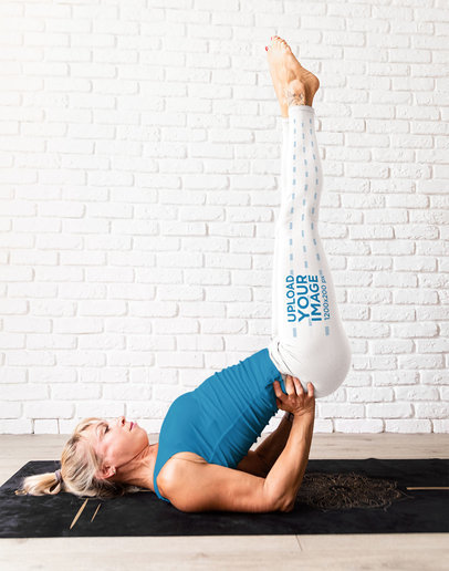 Side Leggings Mockup Featuring a Woman Practicing Yoga M4295-r-el2