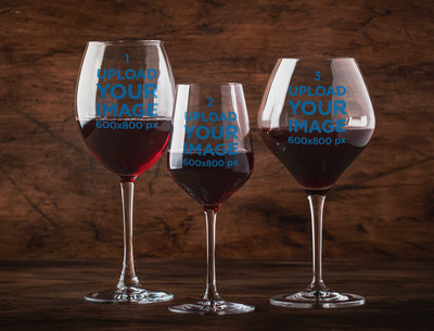 Mockup Featuring Three Customizable Wine Glasses Against a Wooden Background m3061-r-el2