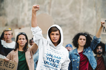 Mockup Featuring a Young Woman Wearing a Hoodie at a Protest m4540-r-el2