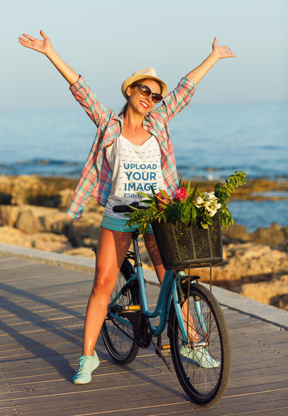 Tank Top Mockup of a Woman Riding a Bike by the Ocean 36130-r-el2