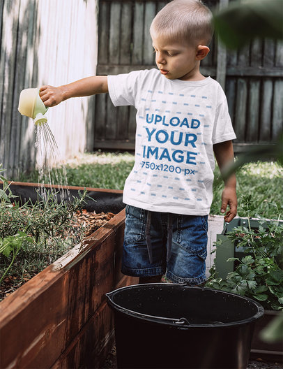 T-Shirt Mockup of a Little Boy Watering the Plants of a Garden 44346r-el2