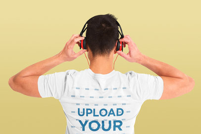 Back View Mockup of a Man Wearing a T-Shirt and Listening to Music at a Studio 42688-r-el2