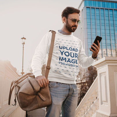 Crewneck Sweatshirt Mockup of a Man With a Bag Checking His Phone m4213-r-el2