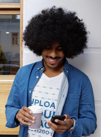 V-Neck Tee Mockup of a Man Checking His Phone 38974-r-el2