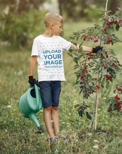 Basic T-Shirt Mockup of a Kid Planting a Small Tree 44946-r-el2