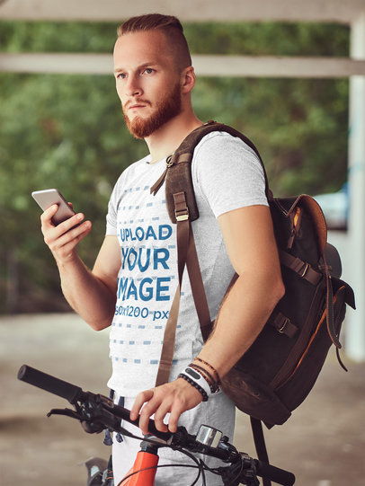 Mockup of a Red-Haired Bearded Cyclist Wearing a Heather Tee 37727-r-el2