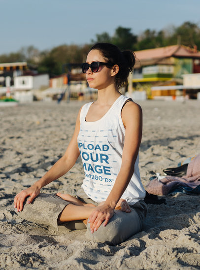Mockup of a Woman Wearing a Tank Top While Meditating at the Beach 38130-r-el2