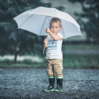 T-Shirt Mockup of a Little Boy Standing in the Rain 42911-r-el2
