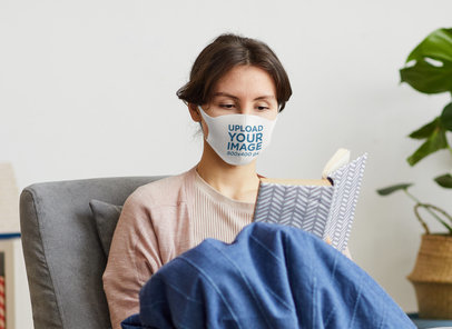 Mockup of a Woman Reading in her Living Room with a Face Mask M3718-r-el2