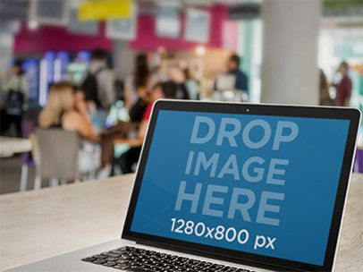 Macbook Mockup Template at a Crowded Cafeteria a4640