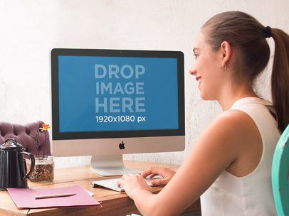 iMac Mockup Template of a Young Woman at a Creative Studio a4873