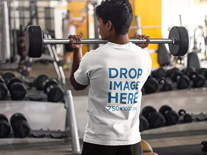 T-Shirt Mockup Featuring Man at the Gym Lifting Weights  a8167