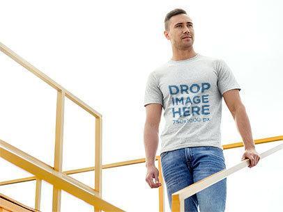 Man Standing on Sports Stadium Bleachers T-Shirt Mockup a8677