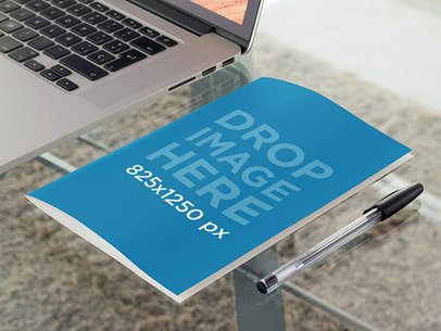 Bifold Brochure Mockup Lying Next to a Laptop in an Office a10308