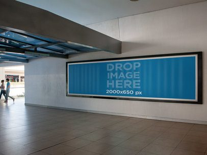 Horizontal Banner Mockup Placed on a Mall's Wall a10511
