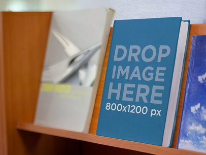 E-Book Mockup Standing on a Shelf at a Bookstore b9890