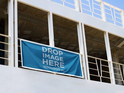 Horizontal Banner Mockup Hanging From a Balcony in a Stadium a10635