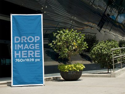 Vertical Banner Mockup Standing Outside a Modern Convention Center a10542