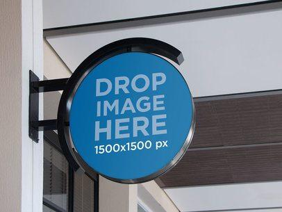 Circular Sign Mockup Hanging From a Wall a11356