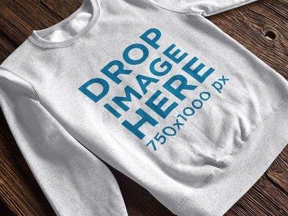 Crew Neck Sweatshirt Mockup Over a Wooden Table a10278
