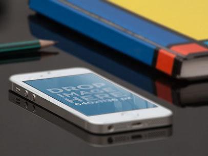 iPhone SE Mockup Lying on a School Desk a12256