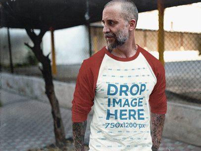 Man Wearing a Simple Raglan T-Shirt Mockup at a Downtown Alley b12603