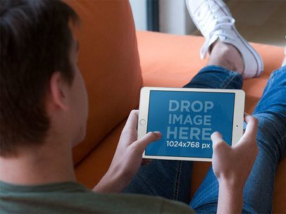 iPad Mockup in Landscape Position Featuring a Man Resting on a Sofa 13058s