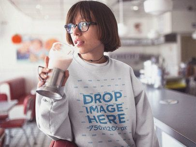 Asian Girl with Glasses Sipping on a Milkshake at a Diner Crewneck Mockup b12666