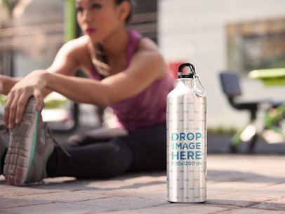 Young Hispanic Girl Doing Exercises With an Aluminum Water Bottle Template Standing Near Her a14873