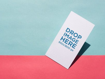 Business Card Lying on a Light Blue and Pink Surface a15011