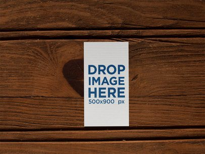 Vertical Business Card Mockup Lying on a Wooden Surface a15019